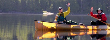 yellow Kevlar canoe with paddlers on Snowbank Lake